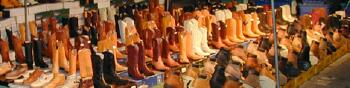 Indio, California flea market, night market, open air market - piicture of boots for sale
